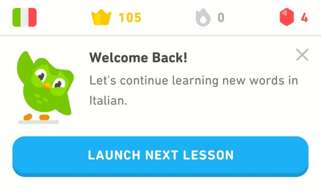 The Duolingo owl waves at the top of the screen next to the words 'Welcome back!' above a button that says 'launch next lesson'