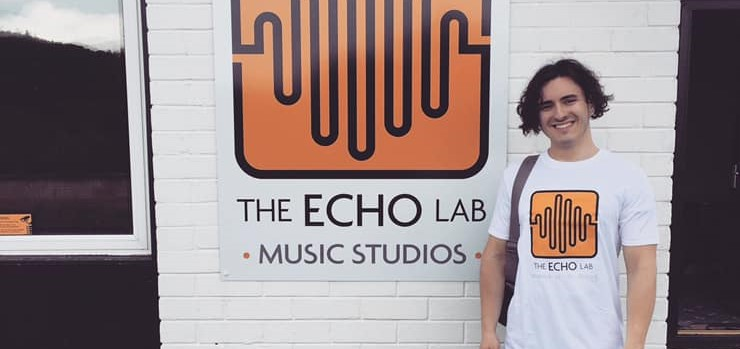 Rapper Elliot Stradling stands outside The Echo Lab music studios